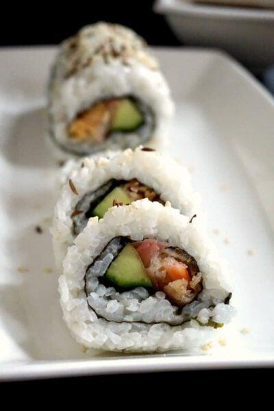 A white rectangle plate with 3 shrimp tempura rolls