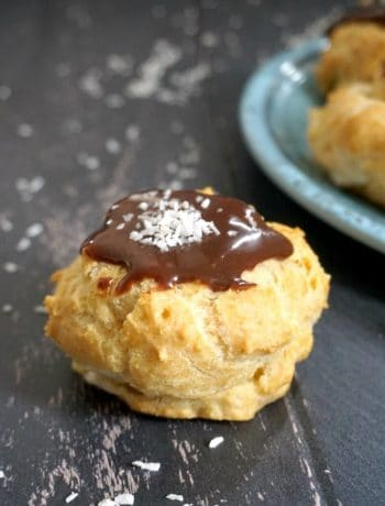 A profiterole on a black background