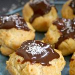 Easy Profiteroles Recipe with vanilla cream filling and topped with chocolate sauce, or cream puffs, one of the most delicious bite-size French desserts. The perfect chocolate treat for any party.