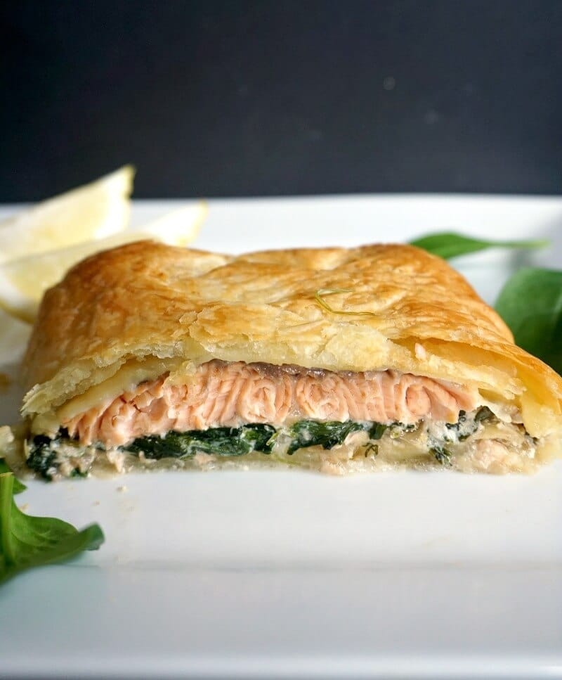 Half a Salmon Wellington on a white plate