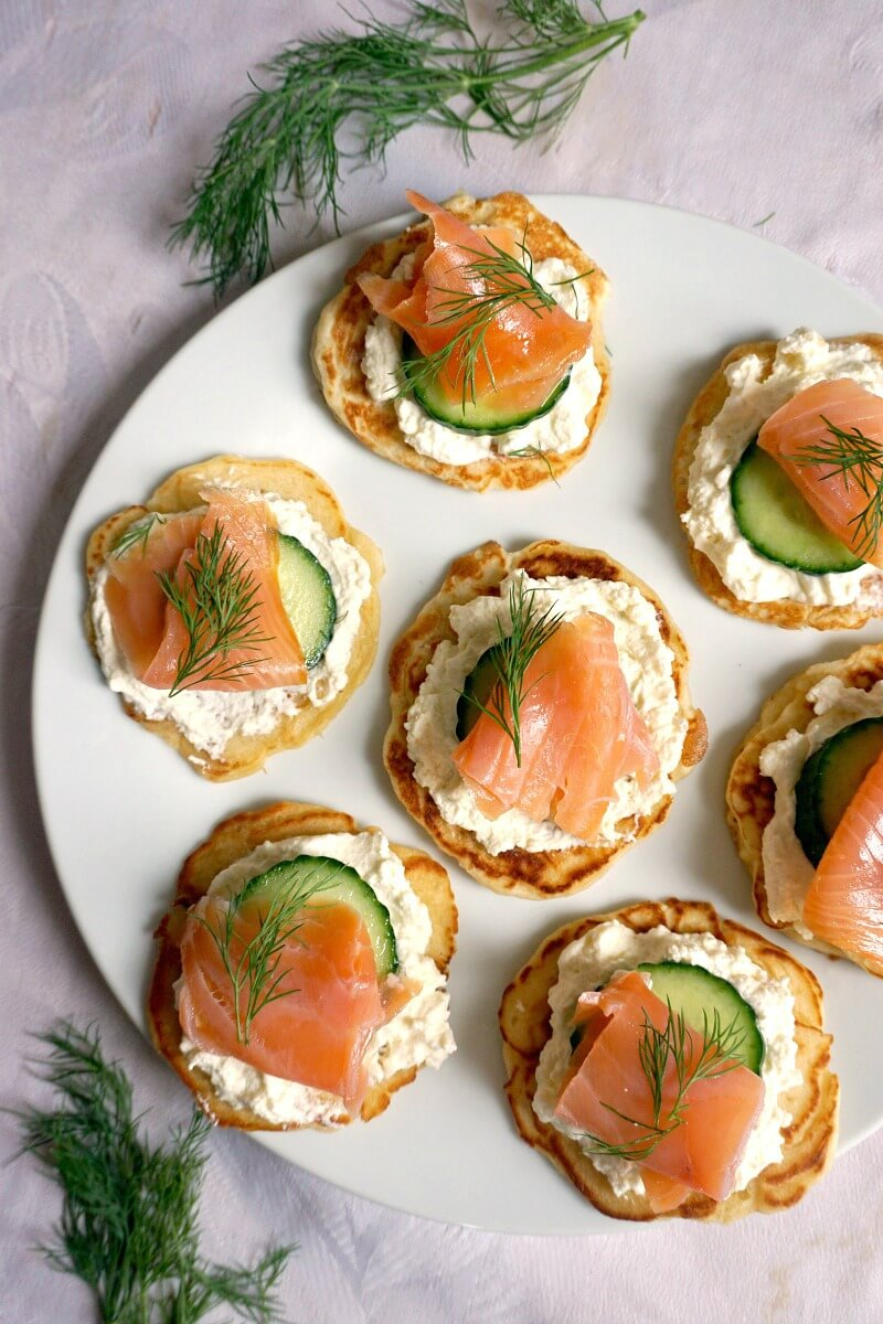 Overhead shoot of a white plate with 7 Smoked Salmon Blini Canapés