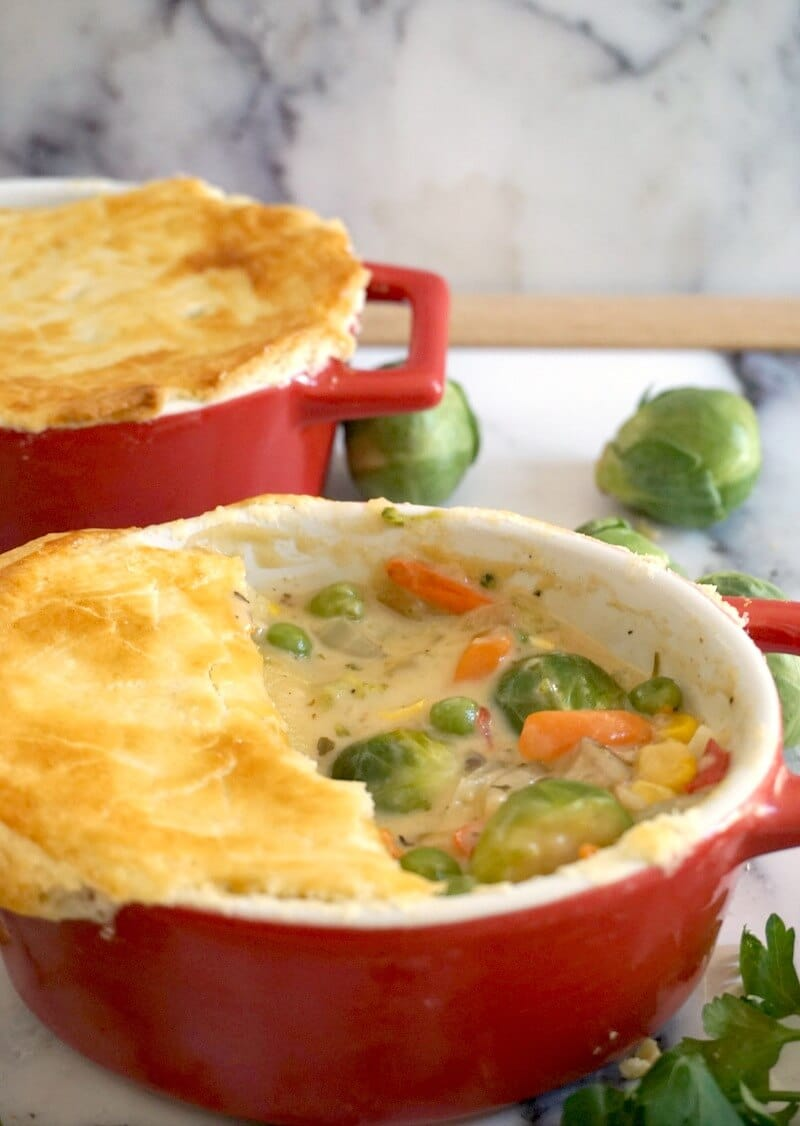 2 red dishes of vegetable pot pie