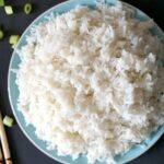 Overhead shoot of a light blue plate with fluffy basmati rice