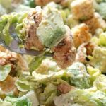 Healthy Grilled Chicken Caesar Salad with avocado and a light yogurt dressing, a healthier version of the classic caesar salad. Super quick and easy to make, this is a great recipe for a work lunch or light dinner. The chicken is well seasoned, and the avocados add more goodness to the salad. You can swap lettuce for any other salad leaves, and leave the croutons out for a low-carb version. #caesarsalad, #salad, #grilledchicken, #avocado, #summer recipes