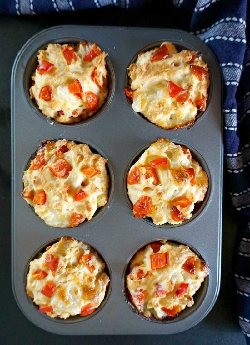 Overhead shoot of a 6-hole muffin tin with 6 savoury muffins