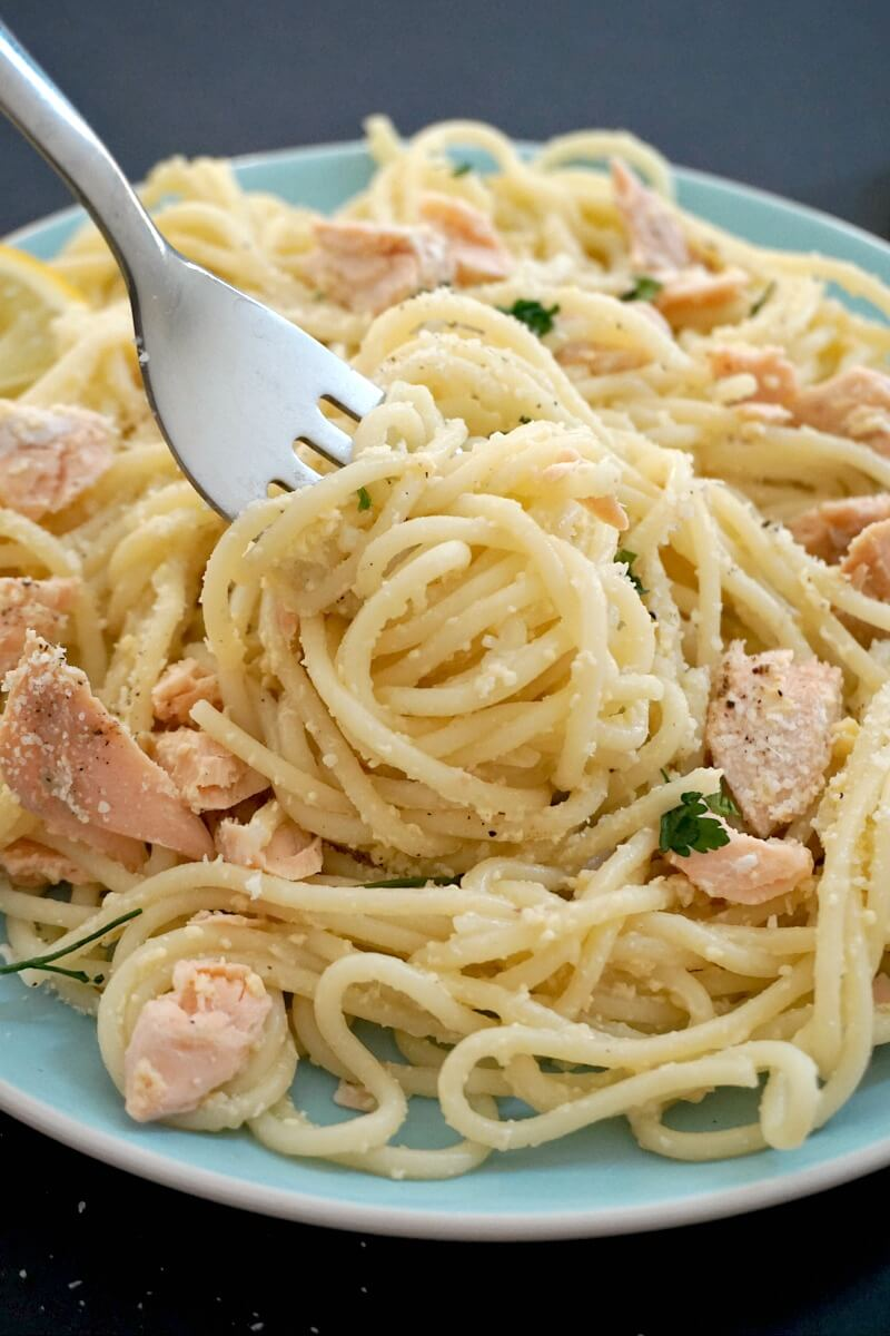 A close-up shoot of a plate with salmon pasta carbonara