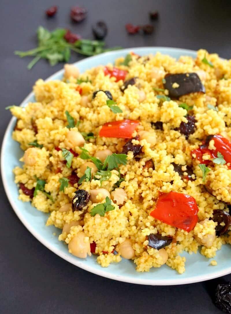 A light blue plate with couscous salad