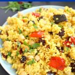 Moroccan Couscous Salad with Chickpeas and harissa roasted vegetables, a deliciously spiced vegan dish full of colour and flavour. Ready in about 20 minutes, this salad is absolutely delicious. The harissa paste gives it a distinctive exotic flavour and an earthy heat. The dried fruit work beautifully with the roasted vegetables. Best served cold as a side or a meal on its own. A great working lunch idea. #couscoussalad, #moroccancouscoussalad, #salad, #couscous, #worklunchideas