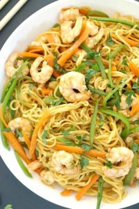 Spicy Shrimp Stir-Fry with Noodles, a delicious Asian dish bursting with the most amazing flavours. Ready in well under 20 minutes, this shrimp stir fry is so easy to make, and the homemade sauce is so good. A great midweek dinner for spicy food lovers. It's a great stir fry if you celebrate the Chinese New Year, but it can also be enhoyed any other time of the year. The shrimp can be swapped for any other seafood of your choice. #stirfry, #shrimp, #noodles, #chinesefood, #shrimpstirfry