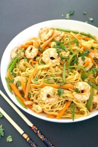Spicy Shrimp Stir-Fry with Noodles, a delicious Asian dish bursting with the most amazing flavours. Ready in well under 20 minutes, this shrimp stir fry is so easy to make, and the homemade sauce is so good.A great midweek dinner.