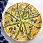 Overhead shoot of a asparagus, mushroom and leek quiche