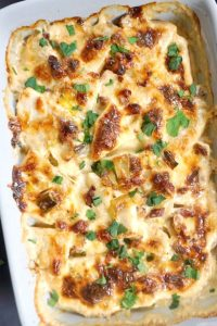 Creamy Celeriac Gratin with Bacon and Leeks, a delicious low-carb side dish that screams comfort food. It's the perfect side for any roast, and makes a great choice for your Thankgiving or Christmas menu, or any other celebration. This celeriac gratin is very easy to make, with little prep. It's comforting, and makes a great alternative to the potato gratin. #celeriacgratin, #sidedish, #lowcarbsidedish, #lowcarbrecipes, #christmasfood
