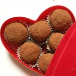 No-Bake Coconut Balls or Coconut Truffles made with desiccated coconut and condensed milk, then covered in cocoa powder, a sweet bite-size treat not only for your better half, but also for friends and family. Just 4 ingredients, and you have the perfect recipe to win anybody's heart. A great dessert for any party or family gathering, these coconuts balls with condensed milk are the perfect dessert for Valentine's Day. #coconutballs, #condensedmilk, #valentinesday, #dessert, #nobakedessert