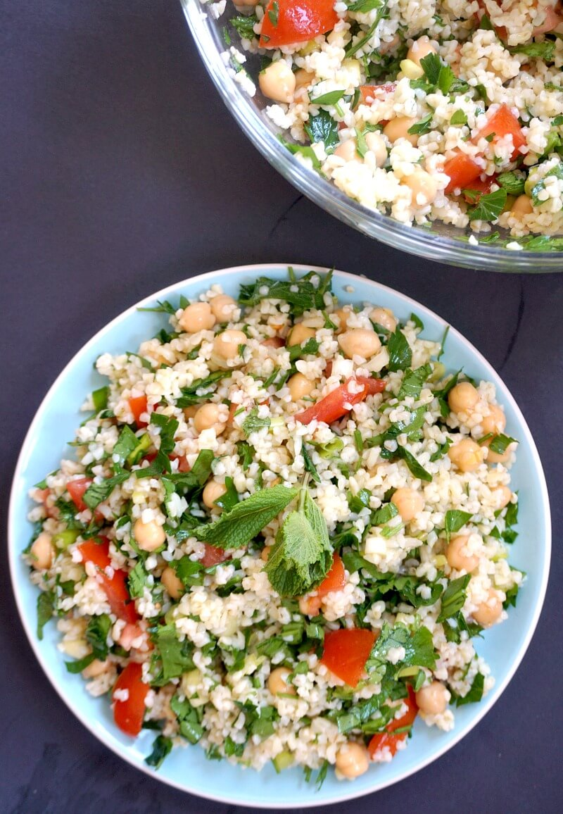 Overhead shoot of a blue plate with tabbouleh