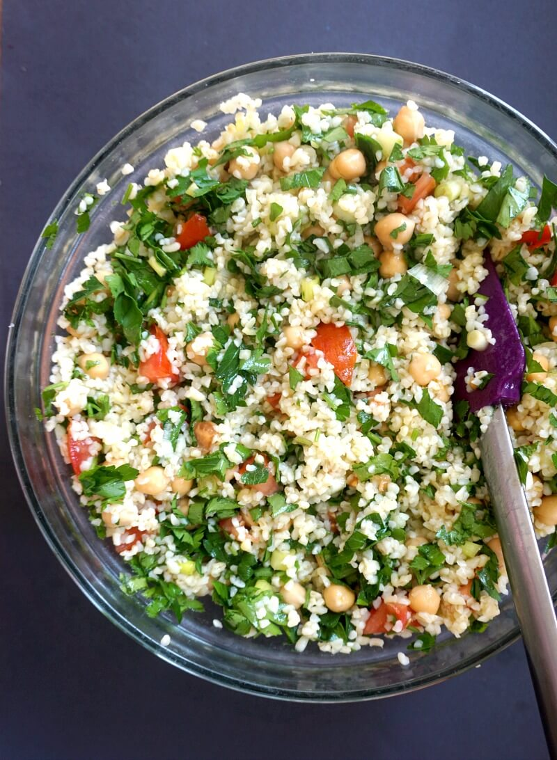 Overhead shoot of a glass bowl with tabbouleh salad