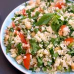 Close-up shoot of a blue plate of tabbouleh