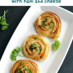 Puff Pastry Pinwheels with Ham and Cheese, a fancy appetizer for any family gathering, party or picnic. Easy to make, with a delicate smokey flavour, these bites will not last long on the plate. Make sure you grab one before they are gone!