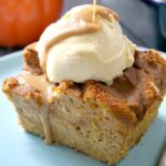 A slice of pumpkin bread pudding on a light blue plate