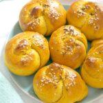 A plate with 6 pumpkin dinner rolls