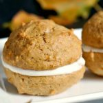 Pumpkin Whoopie Pies with Maple Cream Filling, a scrumptious Fall dessert. Soft pumpkin spiced cookies sandwiched together with a rich maple cream cheese filling; a treat on Thanksgiving! Quick and easy to make, perfect for sharing!