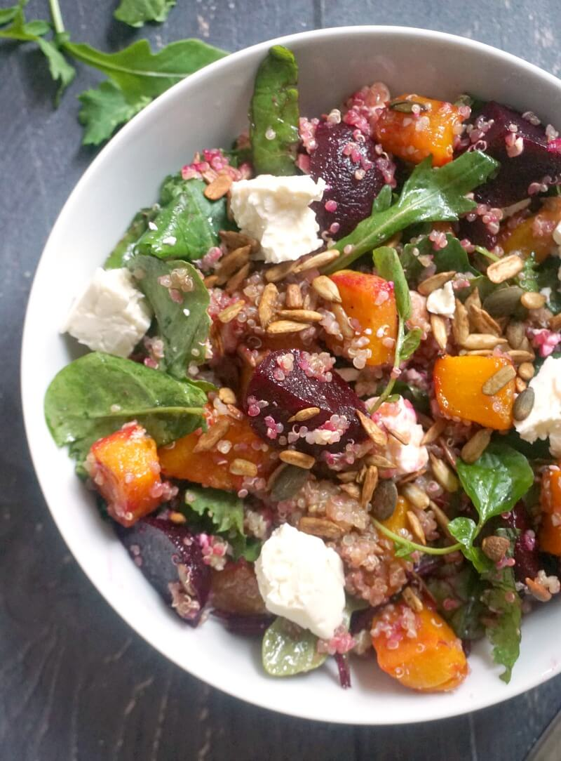 A white bowl with pumpkin and quinoa salad