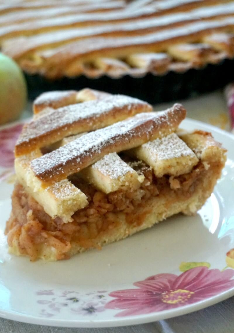 A slice of apple pie on a white plate