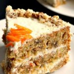 Moist Carrot Cake recipe from scratch with vanilla cream cheese frosting, the best homemade dessert to be baked all year round, especially for Easter or Christmas. It's absolutely delicious, and the earthy spices bring so much flavour. It's so easy to make, that even a complete beginner can bake it. A family-favvourite dessert. #carrotcake, '#moistcarrotcake, #dessert, #bestdesserts, #easter, #christmas