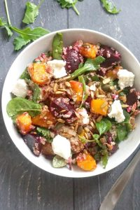 Healthy Roast Pumpkin Quinoa Salad with Feta, beetroot, mixed green leaves, and toasted sunflower and pumpkin seeds drizzled with a light balsamic vinegar and honey dressing, easy and nutritious salad that makes a fantastic side dish ffor Thanksgiving or even a meal on its own. A great packed lunch option or a light dinner. It can be served warm or cold.