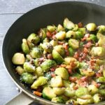 A pan with brussels sprouts with bacon and parmesan