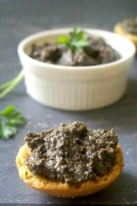 Black Olive Tapenade Recipe, the ultimate party appetizer that is so quick and easy to make, but so big on flavours. The tapenade is made with black olives, anchovies, capers, dijon mustard, lemon juice and olive oil, and blended together to create a simple, but delicious dip for every occasion.Serve it with crostini or bruschetta, or just some simple toast. The best party food for Game Day, New Year's Eve or any other party. #tapenade, #olivetapenaderecipe, #partyappetizer, #gameday, #healthy