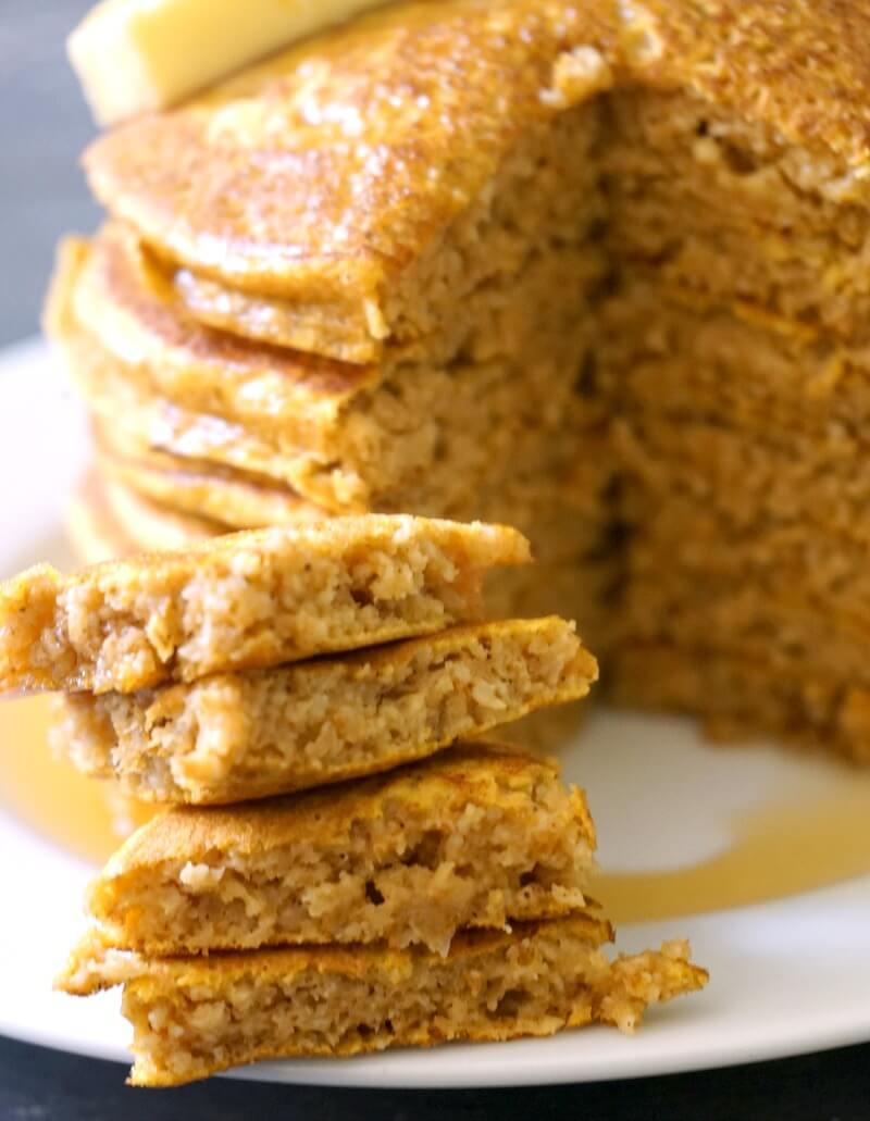 Close-up shoot of oatmeal pumpkin pancakes cut into pieces to show how fluffy they are inside