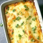 Leftover Chicken, Spinach and Artichoke Lasagna in a cheesy and creamy bechamel sauce, a delicious and easy dinner that takes comfort food to the very next level. In you like the classic spinach and artichoke dip, you will love with chicken lasagna with a twist. Perfect layers of no-boil lasagna sheets, creamy chicken filling and then baked to perfection until bubbly hot. My kind of dinner! #lasagna, #chickenlasagna, #spinachandartichoke, #comfortfood, #chickendinner, #bechamelsauce, #rotisserie