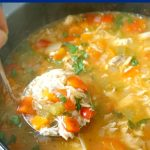 Leftover Turkey Rice Soup, a quick and easy recipe for chilly days. This hearty homemade soup is loaded with veggies for extra goodness, it's healthy, and ready in well under 30 minutes. A favourite soup with kids and grown-ups alike, the soup can be made with leftover chicken too, or any other leftover meat. Comfort food at its best, this turkey soup is soothing and just perfect for colds and flu too #leftoverturkey, #turkeyrecipes, #turkeysoup, #soup, #healthyfood, #kidsfoodideas, #comfortfood
