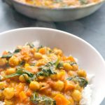 Hearty Coconut Chickpea Curry with fresh spinach, a healthy and delicious meat-free curry that is full of flavours. Mild, but lightly spiced, this vegetable curry is so easy to make, and super quick too. Vegetarian and vegan friendly, but even meat lovers will enjoy it too.It's a fantastic midweek dinner idea, and it's ready in about 30 minutes. This Indian style vegan curry is absolutely amazing. #chickpeacurry, #vegeancurry, #veganrecipes, #midweekdinner, #chickpeas