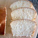 3 slices of brioche bread on a wooden board